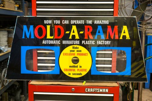 A backboard for a Mold-A-Rama machine. Jones says it is important to maintain the Mold-A-Rama's retro look.