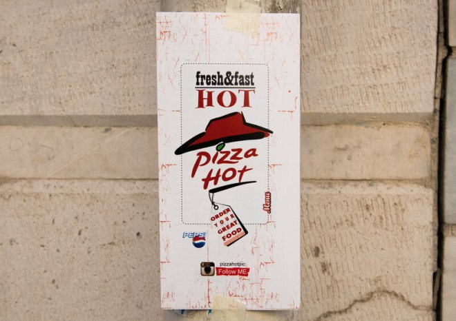 """Pizza Hot"" advertising in Tehran's Central District."