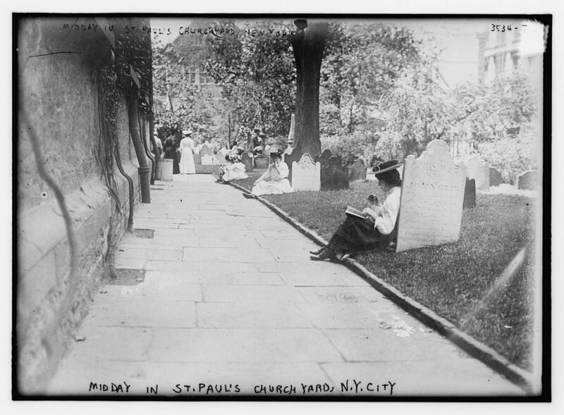 Enjoying a book and a snack in a Lower Manhattan cemetery.