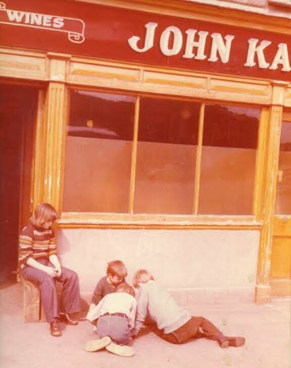 Anne, Anthony, Ciarán, and Eoin play in front of the pub sometime in the late 1970s.