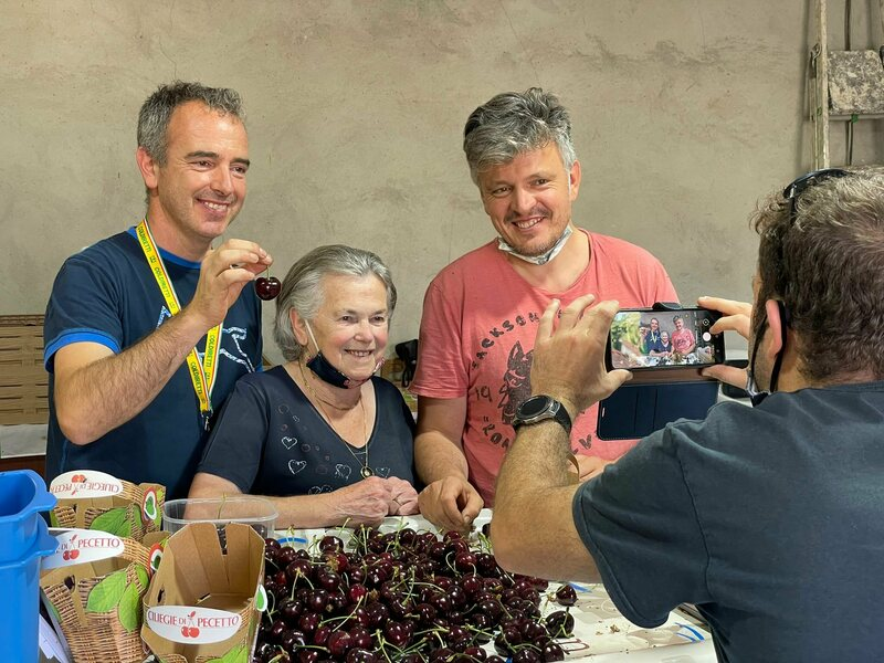 Alberto Rosso (left) celebrates the world record with his mother Maria Teresa Varetto and his brother Giuseppe.