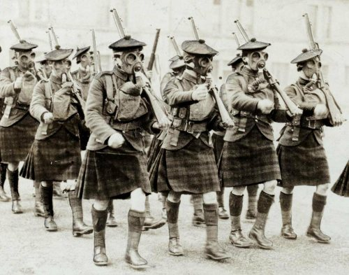 Scottish troops on parade with gas masks during World War I.