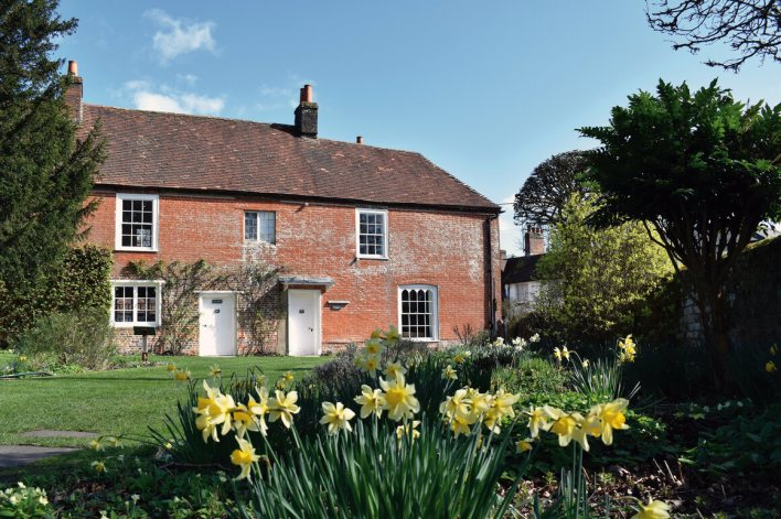 Chawton Cottage, where Jane, Cassandra, and Mrs. Austen lived with Martha Lloyd. The building is now a Jane Austen museum.