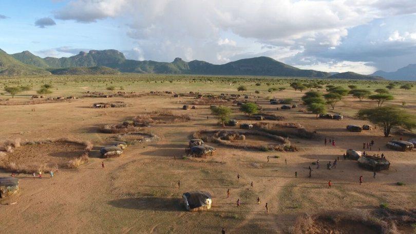 A Samburu village on the edge of Kirisia forest, seen in the background.