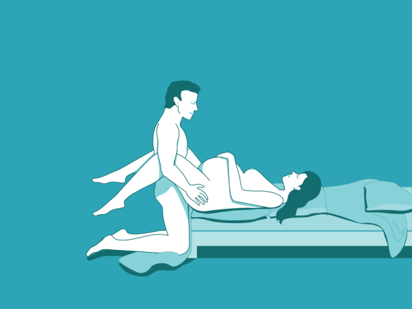 Pregnancy sex position - woman on back with man between legs