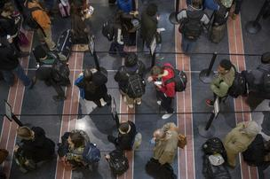 Early users of TSA's PreCheck are finding their once breezy path through security is taking longer as the TSA expands the ranks of those in the program and as agents open the special lanes to other travelers to alleviate congestion.