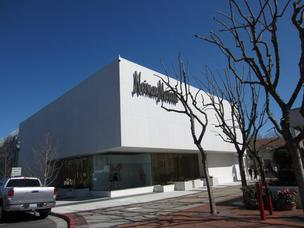 Neiman Marcus may be close to a deal to sell itself to Ares Management and a Canadian pension fund.