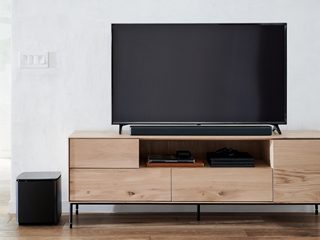 Bose Soundbar 700 with a TV and the Bose Bass Module 700