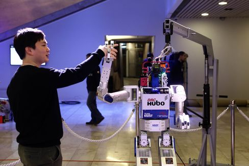 A technician demonstrates the Hubo robot in the Congress Center conference hall in preparation for the start of the World Economic Forum (WEF) in Davos.