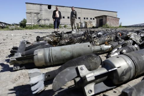 Residents of Kurdyumivka look at an ammunition depot of the Ukrainian forces destroyed by pro-Russian separatists with Russian Krasnopol guided shells after shelling in the village of Kurdyumivka, Donetsk region.