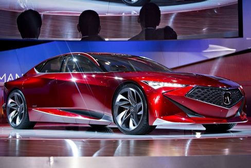 The Honda Motor Co. Acura Precision concept vehicle sits on display after the debut at the 2016 North American International Auto Show (NAIAS) in Detroit, Michigan, U.S., on Tuesday, Jan. 12, 2016. Last year's auto show featured 55 vehicle introductions, a majority of which were worldwide debuts, and was attended by over 5,000 journalists from 60 countries. Photographer: Daniel Acker/Bloomberg