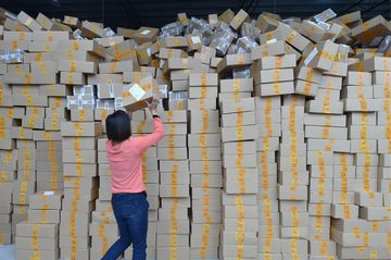 GUANGZHOU, Nov. 11, 2015 -- Workers sort out packages at a sorting center in Guangzhou, capital of south China's Guangdong Province, Nov. 11, 2015. The Singles' Day Shopping Spree, or Double-11 Shopping Spree, Chinese equivalent of Cyber Monday or Black Friday, is an annual online shopping spree falling on Nov. 11 for Chinese consumers since 2009. Each year the express delivery industry will face package peak after the shopping spree. (Xinhua/Liang Xu via Getty Images)