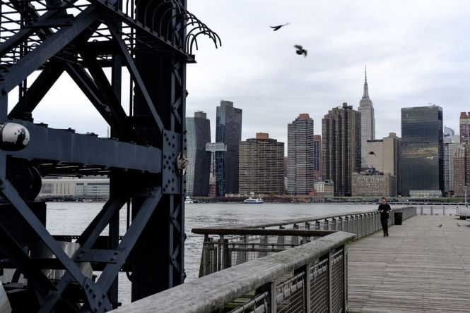 The Manhattan Skyline Stands Across From Gantry Plaza State Park In Long Island City Neighborhood