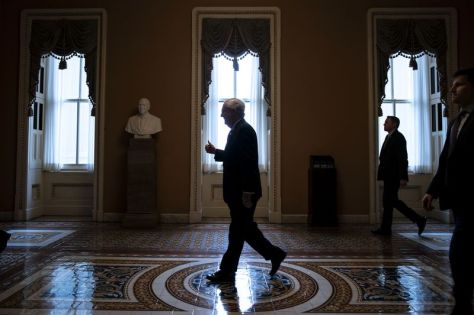 """Senate Majority Leader Mitch McConnell gives a thumbs up as he returns to his office after his opening remarks at the U.S. Capitol in Washington, D.C., U.S., on Wednesday, March 25, 2020. McConnell said """"the Senate is going to stand together and pass this historic relief package today."""""""