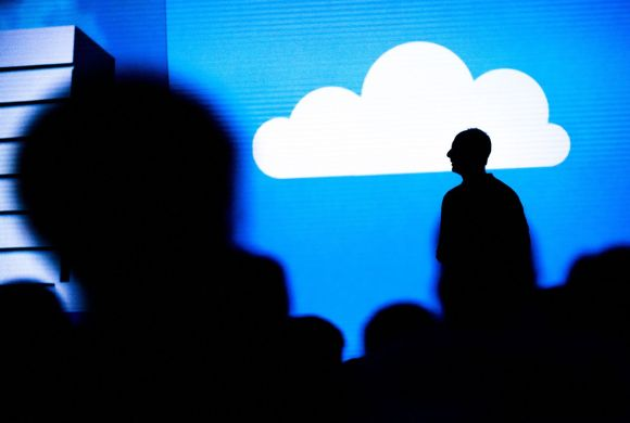 The silhouette of a Microsoft executive speaking during a keynote session at the Microsoft Developers Build Conference in San Francisco on March 31, 2016.