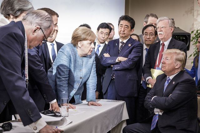 In this photo provided by the German Government Press Office (BPA), German Chancellor Angela Merkel deliberates with U.S. president Donald Trump on the sidelines of the official agenda on the second day of the G7 summit on June 9, 2018 in Charlevoix, Canada. Also pictured are (L-R) Larry Kudlow, director of the US National Economic Council, Theresa May, U.K. prime minister, Emmanuel Macron, French president, Angela Merkel, Yasutoshi Nishimura, Japanese deputy chief cabinet secretary, Shinzo Abe, Japan prime minister, Kazuyuki Yamazaki, Japanese senior deputy minister for foreign affairs, John Bolton, U.S. national security adviser, and Donald Trump.