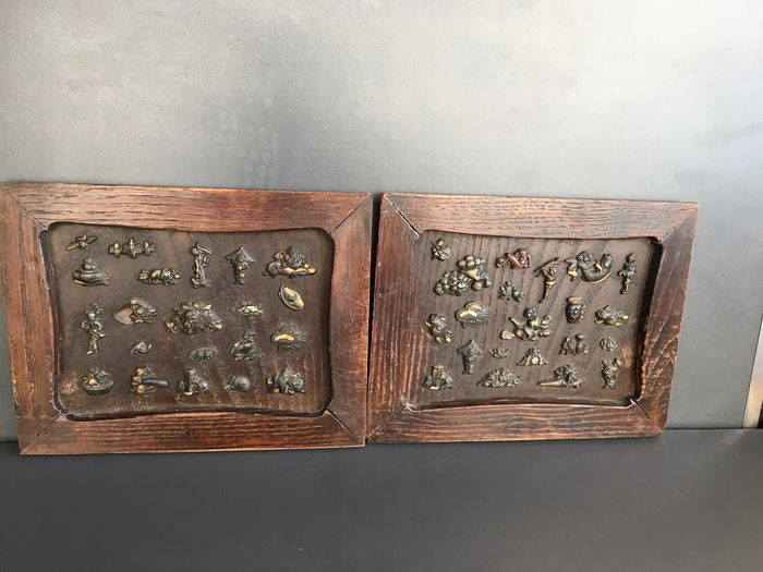two wooden panels with characters, creatures, objects - Brass - Japan - Meiji period (1868-1912)
