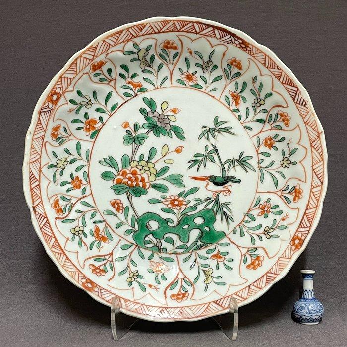 Saucer - Porcelain - Kingfisher on bamboo near chrysanthemum, peonies and pierced rock - Yellow, green, red and black - China - Kangxi (1662-1722)