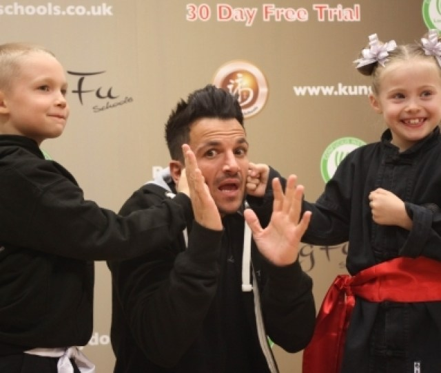 Three Kung Fu Schools Students Peter Andre With A Little Dragon And A Junior Student