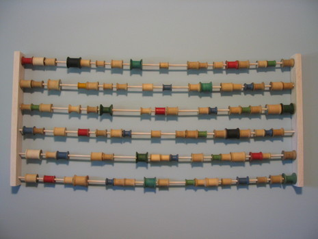 Art abacus using spools of thread