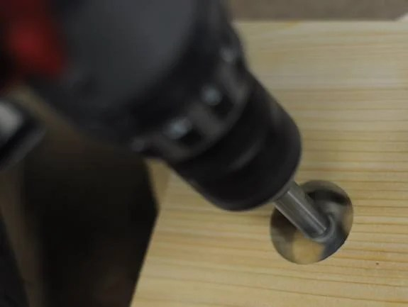 drill a hole using a Forstner bit