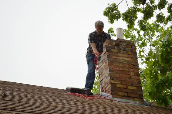 My dad helping out with chimney demolition