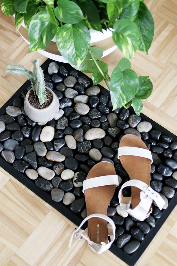 Pebble Bath Mat with shoes and plants