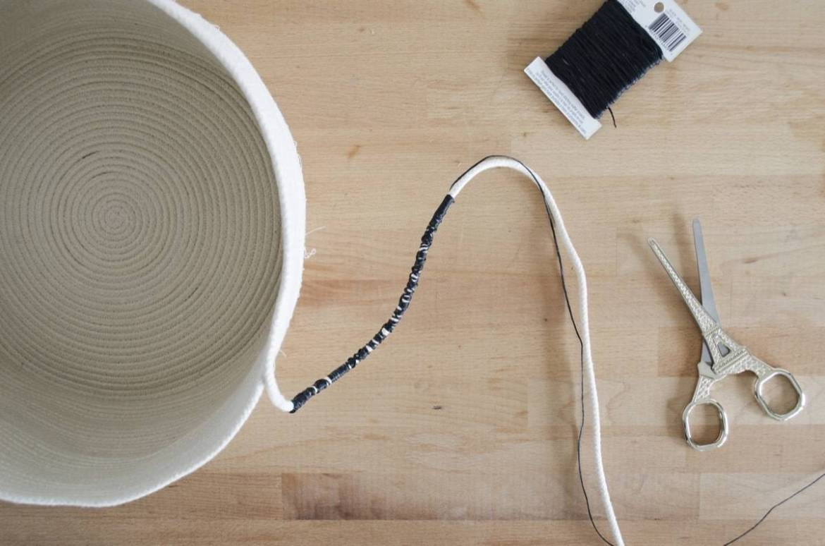 Use thread or floss to wrap your cording as you go to create stripes in your clothesline basket.