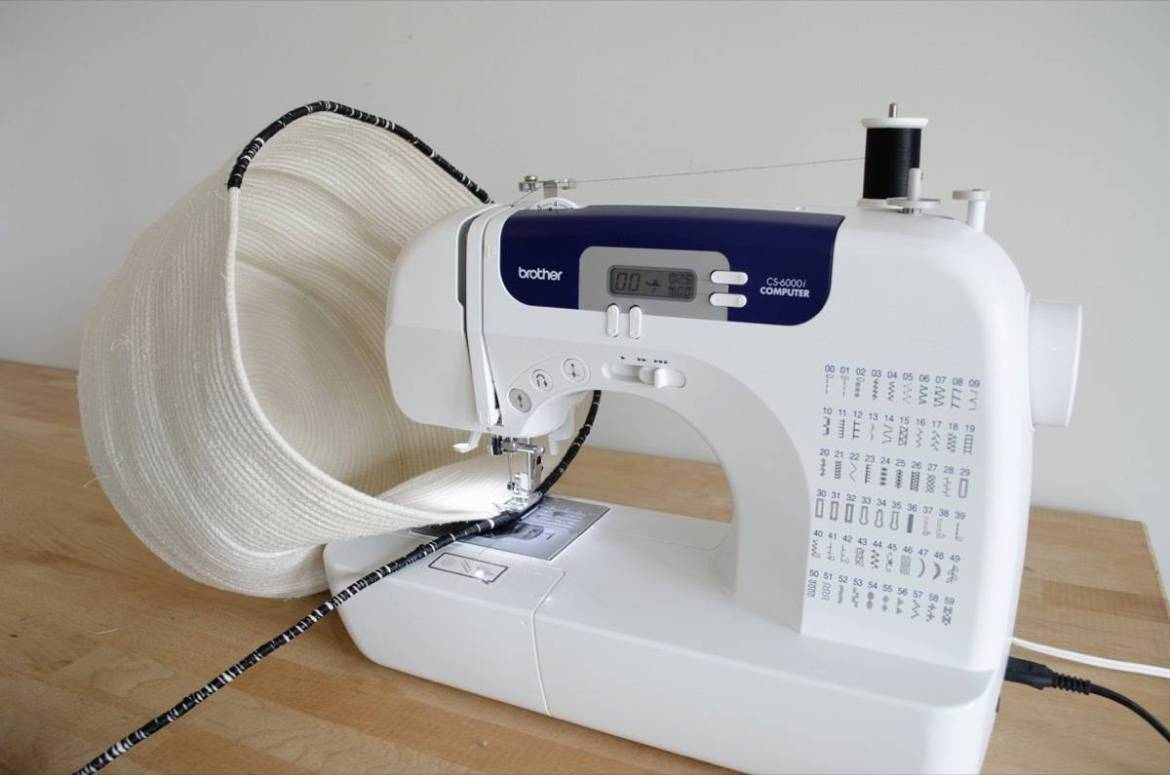 Use alternating thread to create different color patterns while sewing your clothesline basket
