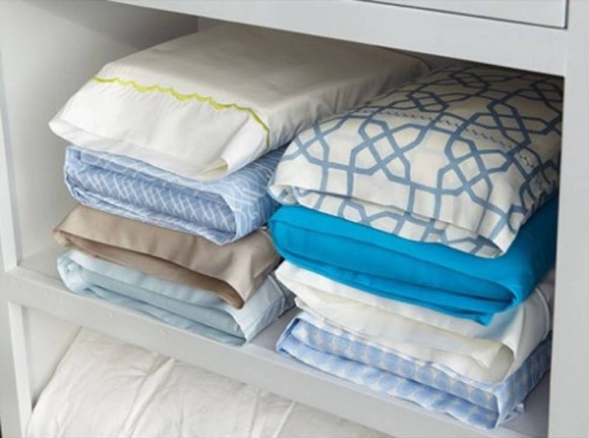 Fold linen sets inside their matching pillowcases | 72 Organization Tips and Projects for Every Space in Your Home