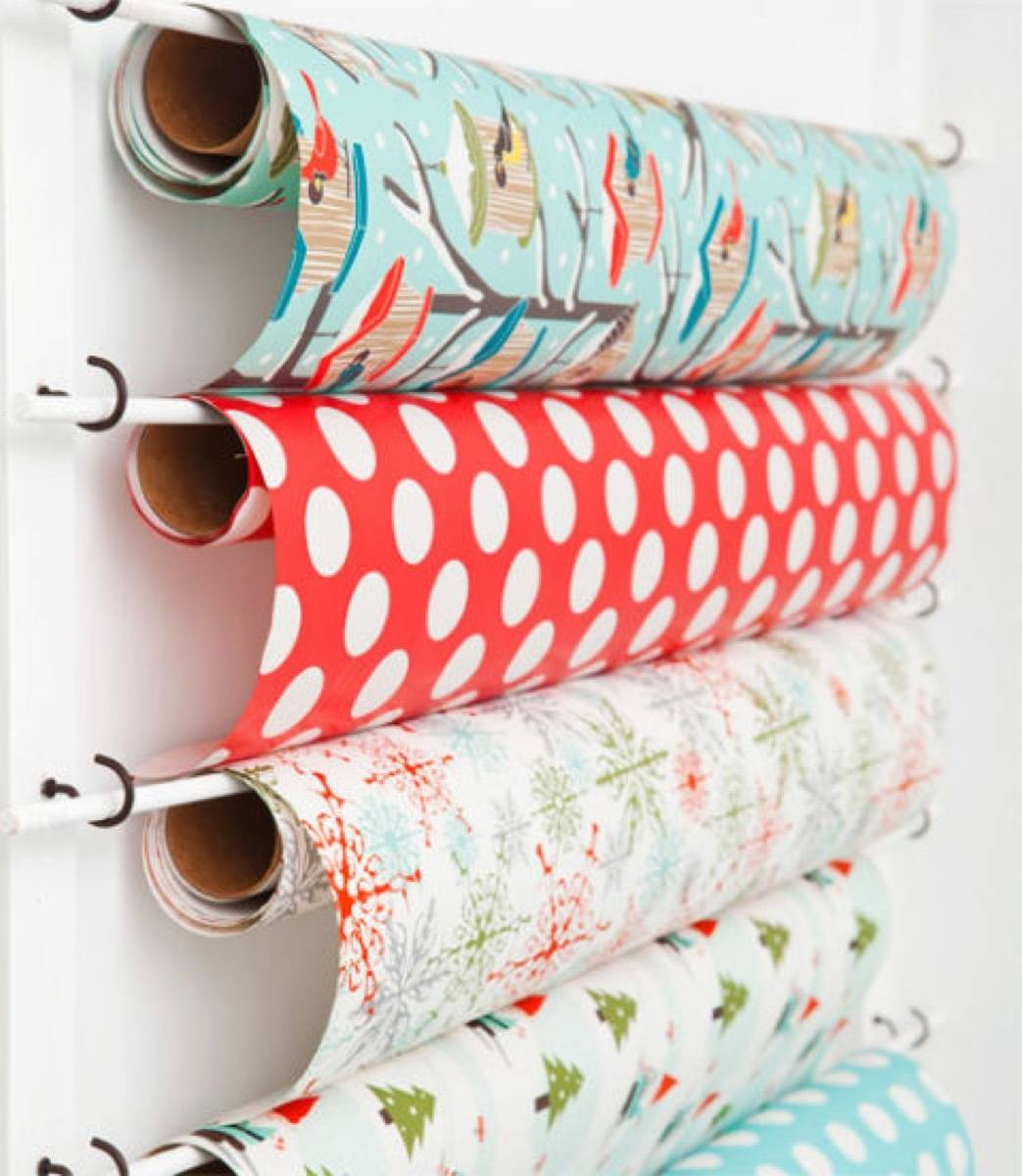 Wrapping paper can be conveniently stored on dowel rods and hooks | 72 Organization Tips and Projects for Every Space in Your Home