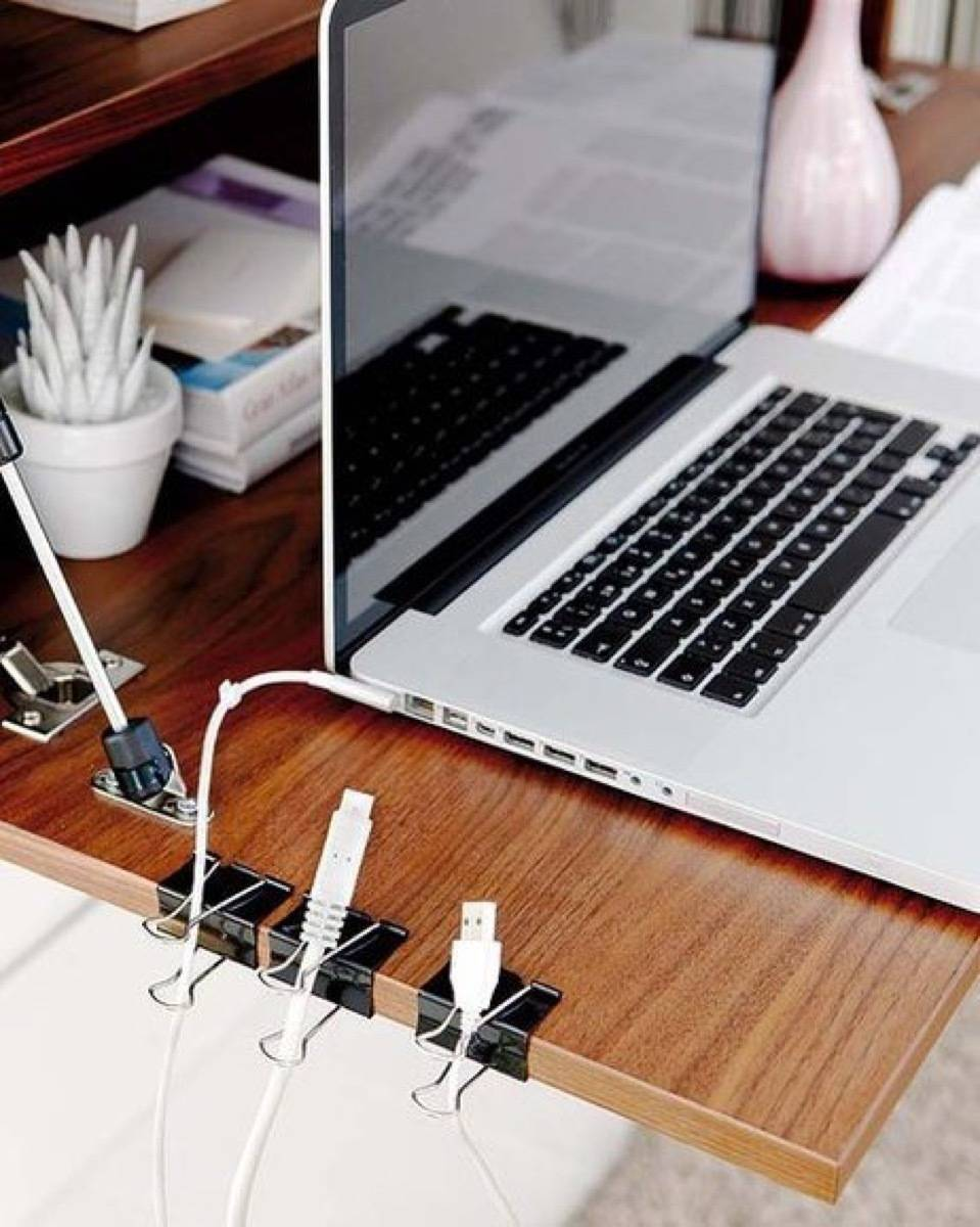 Binder clips are your buddies! Use them to hold cords in place along your desk | 72 Organization Tips and Projects for Every Space in Your Home