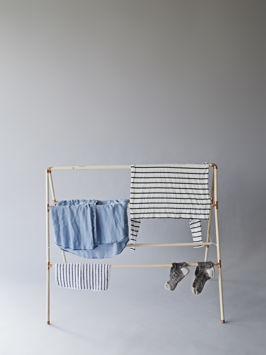Perfect for small spaces - a collapsible wooden drying rack for laundry.