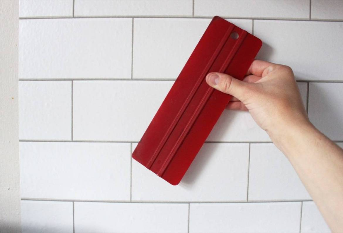 Use a squeegee to install temporary