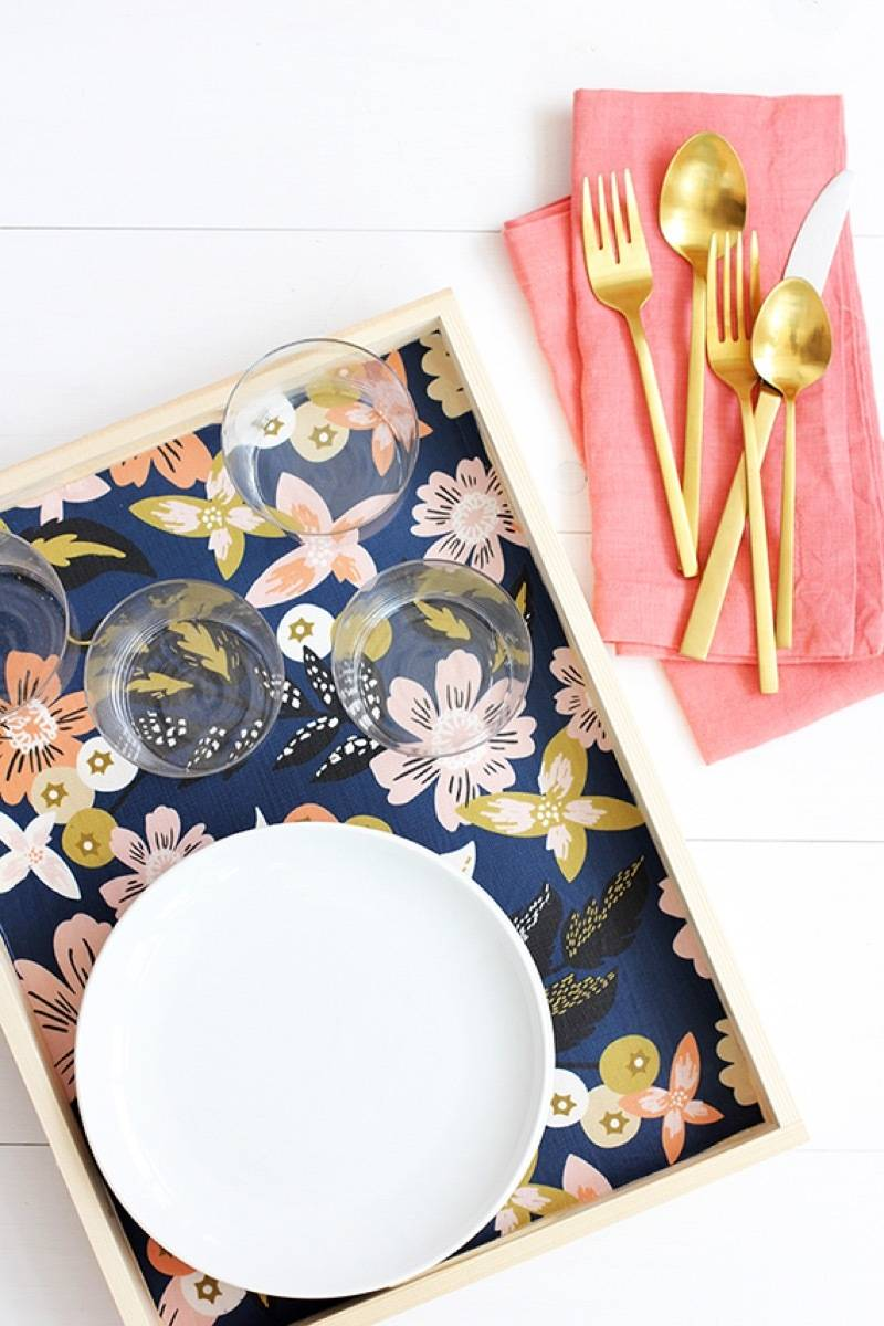 99 ways to use fabric to decorate your home   Line a serving tray