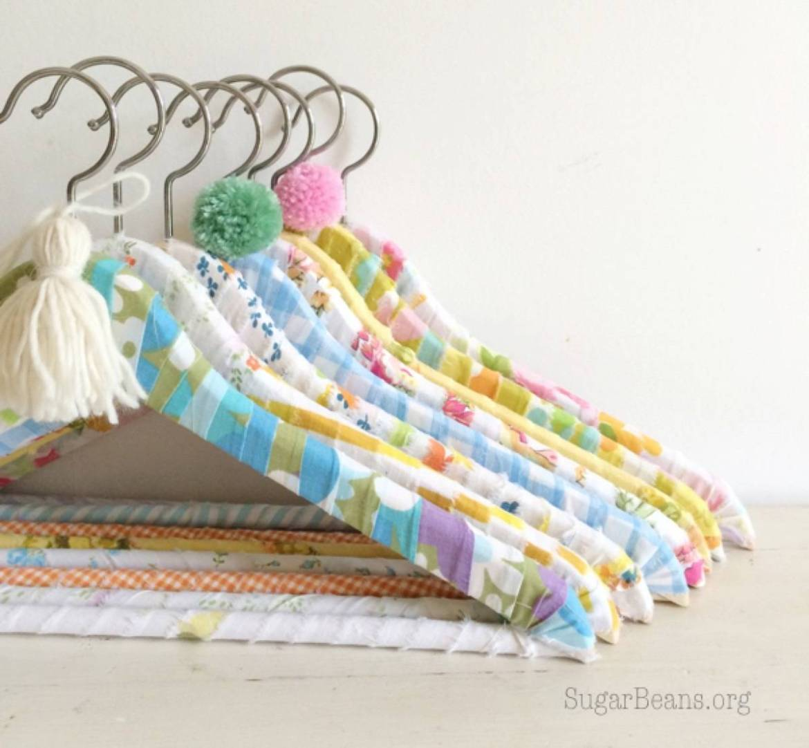 99 ways to use fabric to decorate your home   Wrapped coat hangers