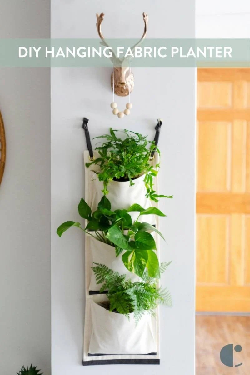 Do your plants drive you up a wall? If not, learn how to make this DIY hanging fabric planter!