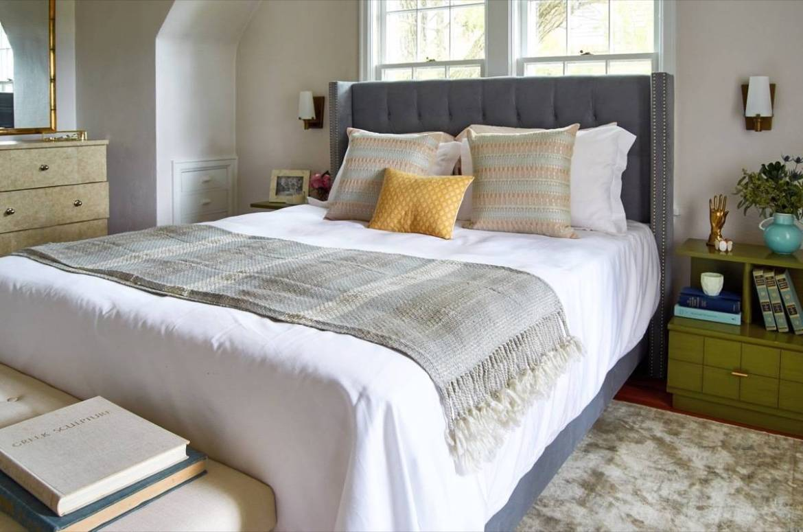Bed with wall sconces