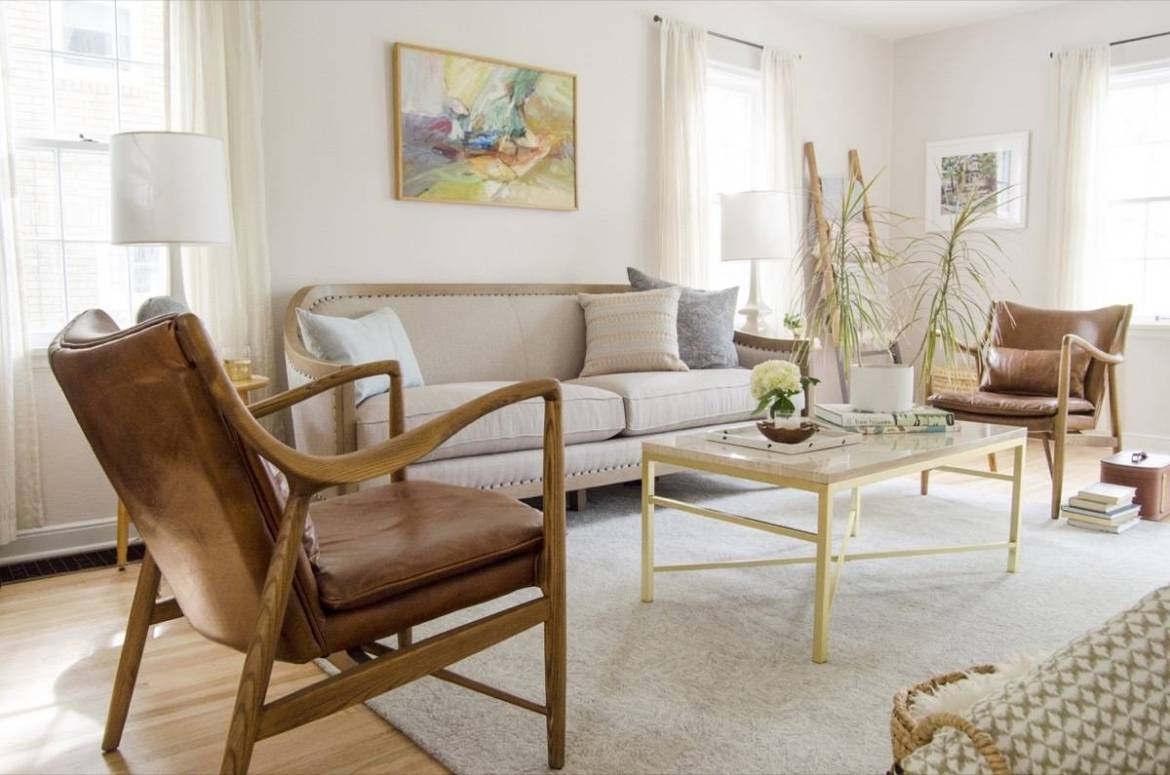 Living room - classic, elegant, leather chair, nailhead trim sofa, gold and marble coffee table