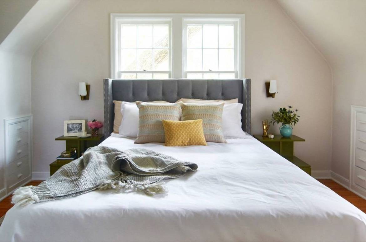 Curbly House master bedroom - upholstered headboard and vintage tables