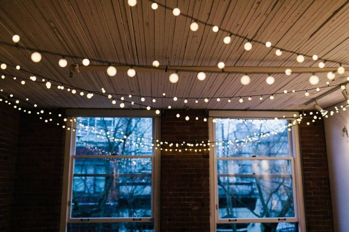 11 Scandinavian Lighting Tricks to Fill Your Home With Hygge | Use string lights to create a festive atmosphere