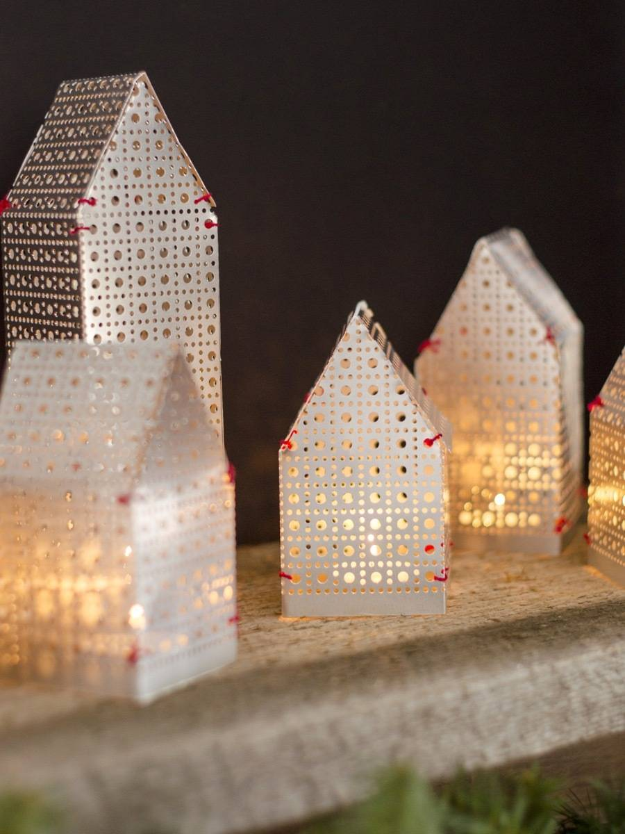 So festive! These house-shaped luminaries were made from a single sheet of metal!