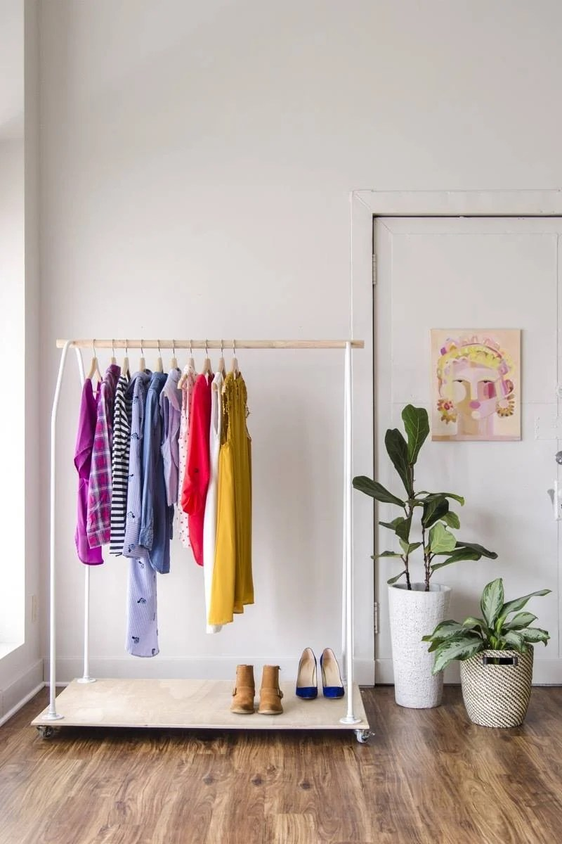 Make a rolling clothing rack from plywood and conduit