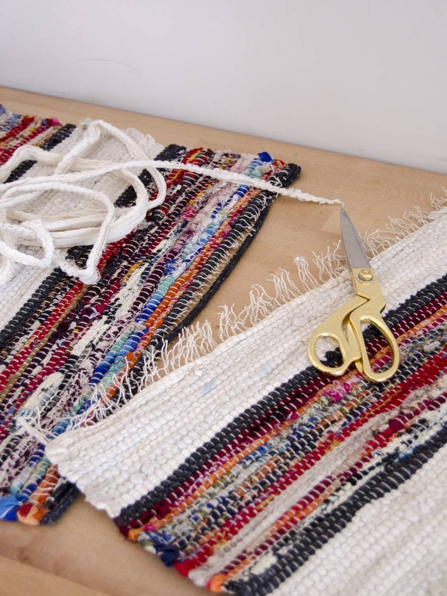 Deconstructing a rag rug for our cheap gallery wall