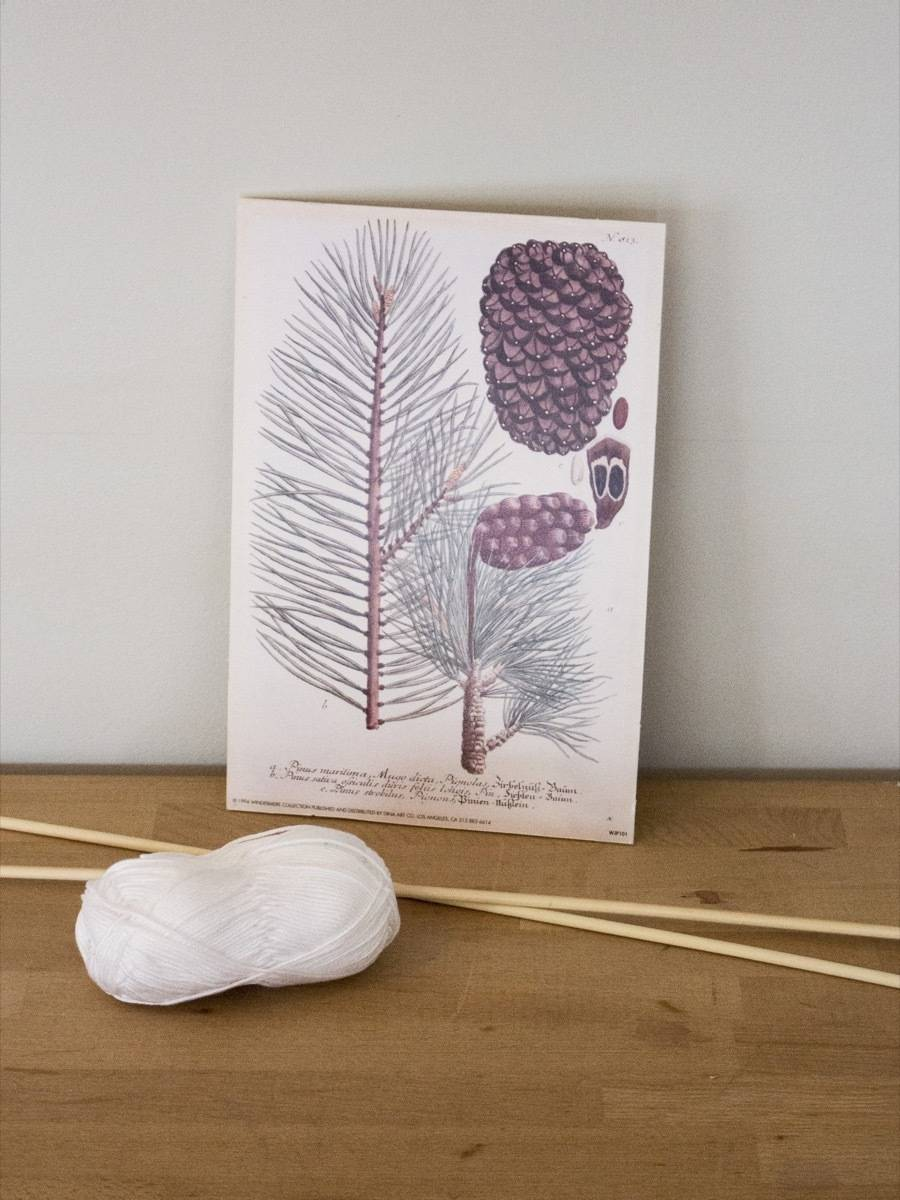 Using skewers and string to hang wall prints