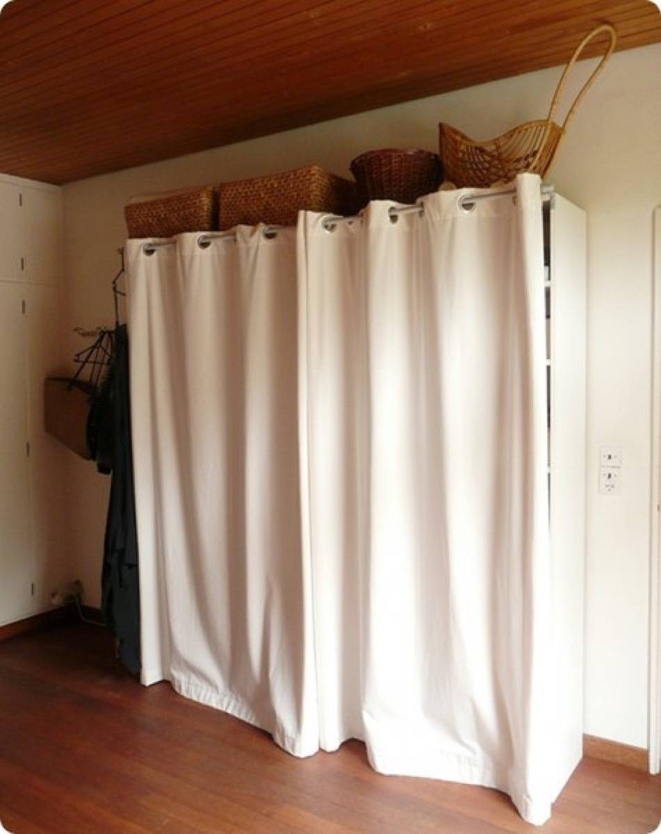 Standing closet surrounded by a curtain