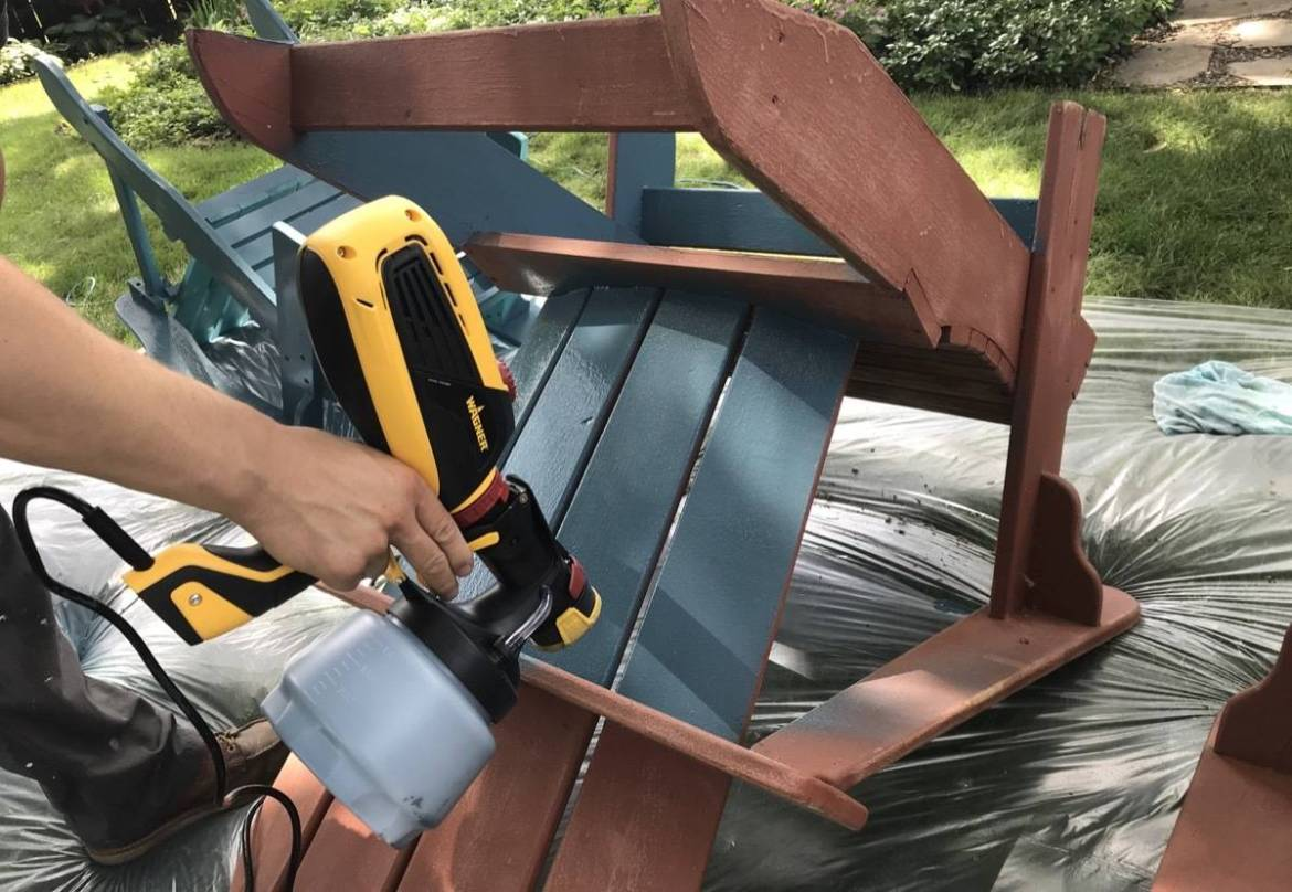 Spraying a patio chair with a Wagner Paint Sprayer