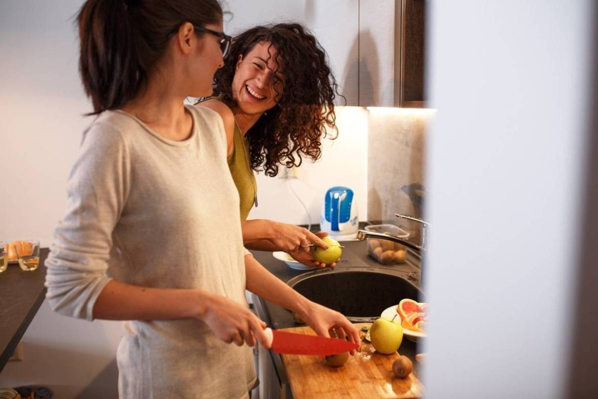 Two friends cooking