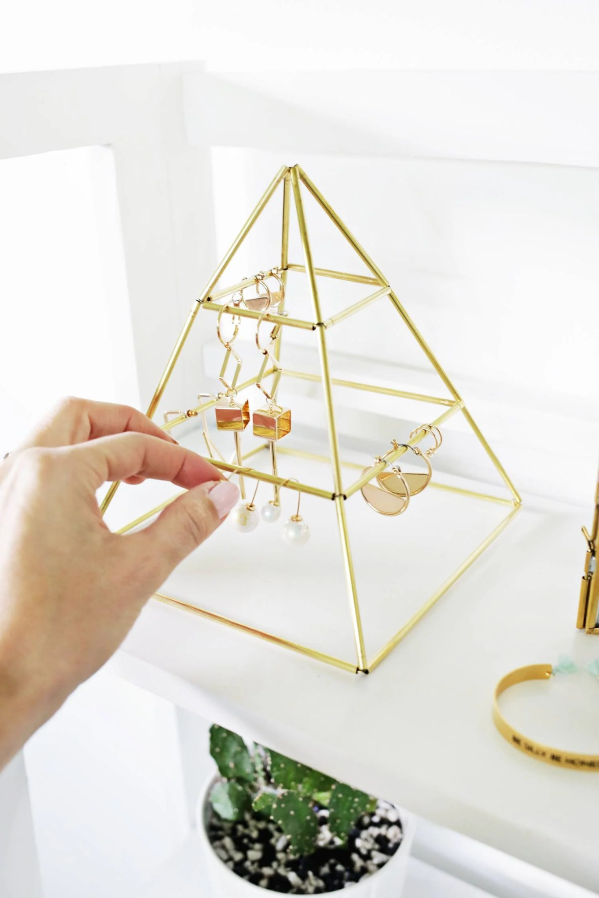 Brass pyramid earring display