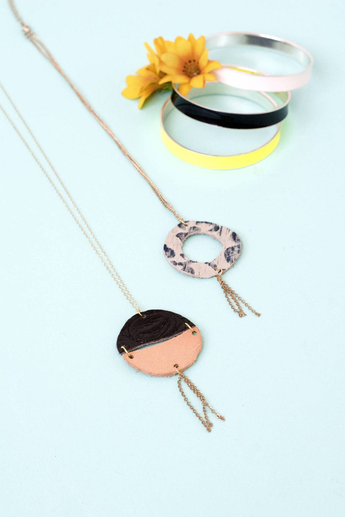 Circular leather pendants on a chain
